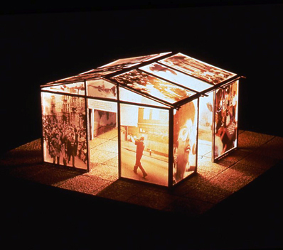 Mixed-media model of the casita illuminated at night.