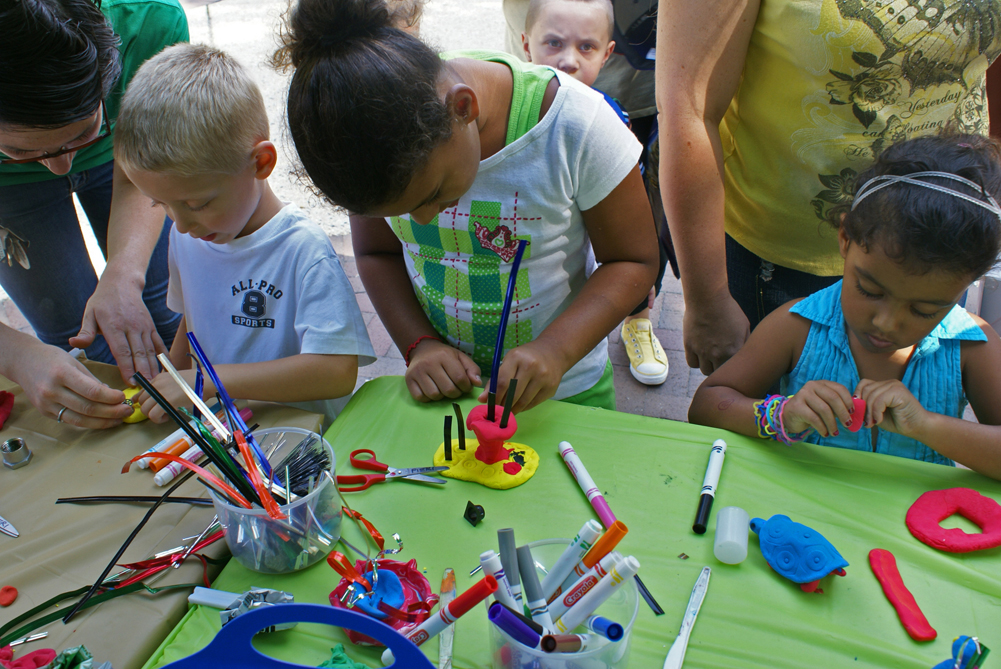 Young sculptors at the Sculpture Saturdays workshop table