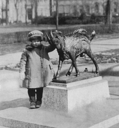 A young girl poses with the Billy sculpture from 1919