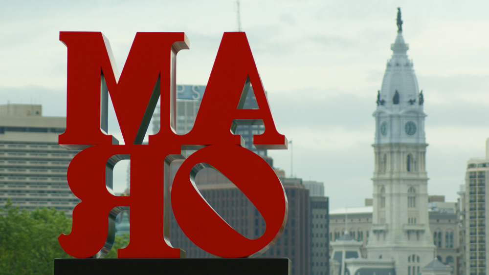 "Looking at Robert Indiana's ""AMOR"" from behind with City Hall in the background"