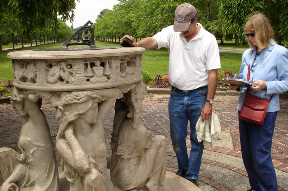 The conservation team inspects Alexander Stirling Calder's <em>Sundial</em> (1903). Photo © Association for Public Art