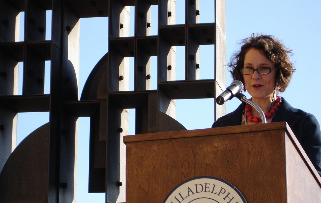 """Maria Nevelson, granddaughter of artist Louise Nevelson, speaks at the rededication of her grandmother's sculpture """"Atmosphere & Environment XII."""""""