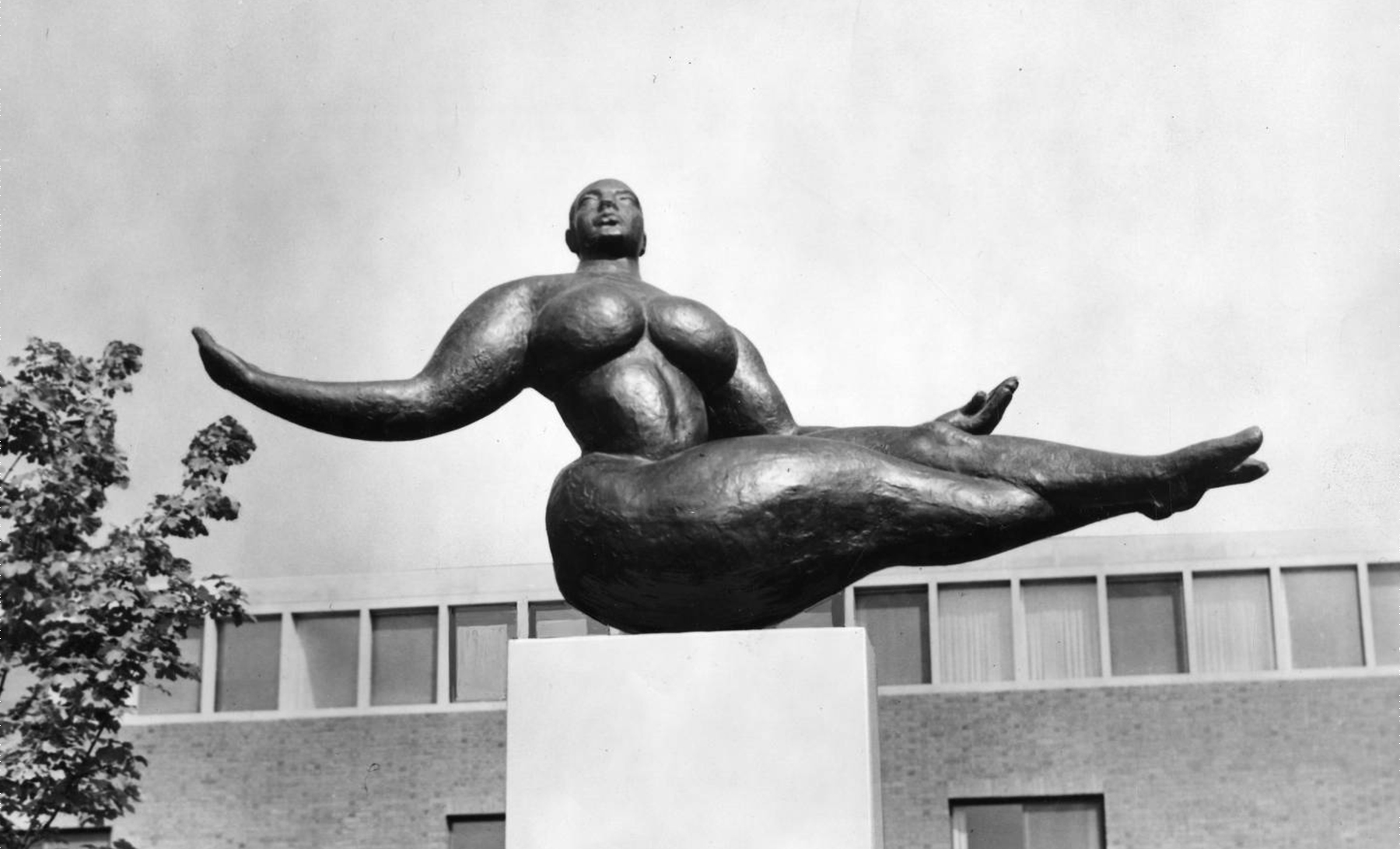 Floating Figure bronze sculpture of a woman with arms outstretched