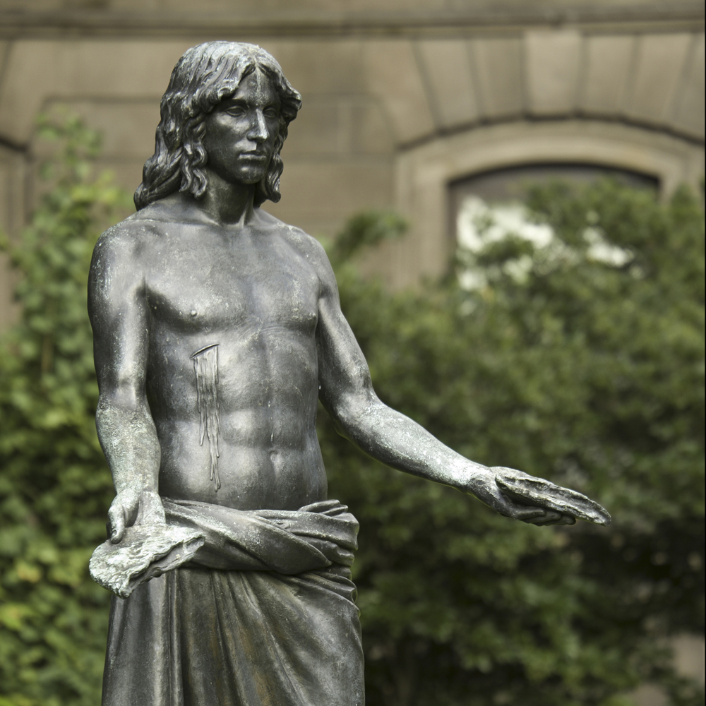 Bronze sculpture Jesus Breaking Bread by artist Walter Erlebacher
