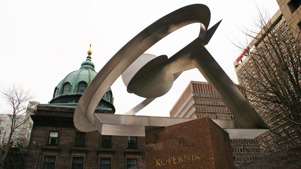 Dudley Talcott's Kopernik sculpture with the Cathedral Basilica of Saints Peter & Paul