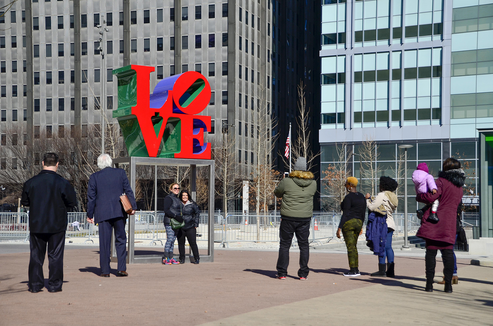 People taking pictures with newly restored LOVE sculpture