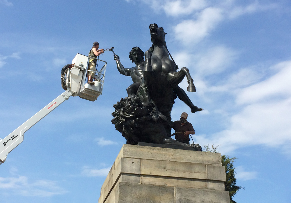 """Conservation of """"The Lion Fighter"""" sculpture in front of the Philadelphia Museum of Art"""