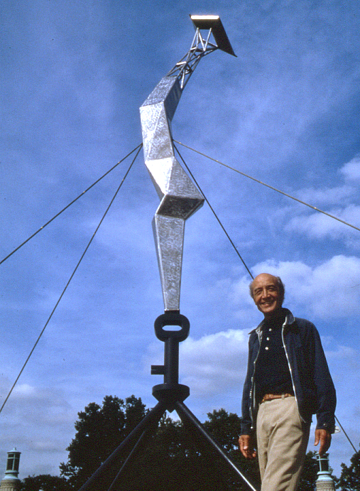 "Artist Isamu Noguchi stands in front of his ""Bolt of Lightning"" sculpture"