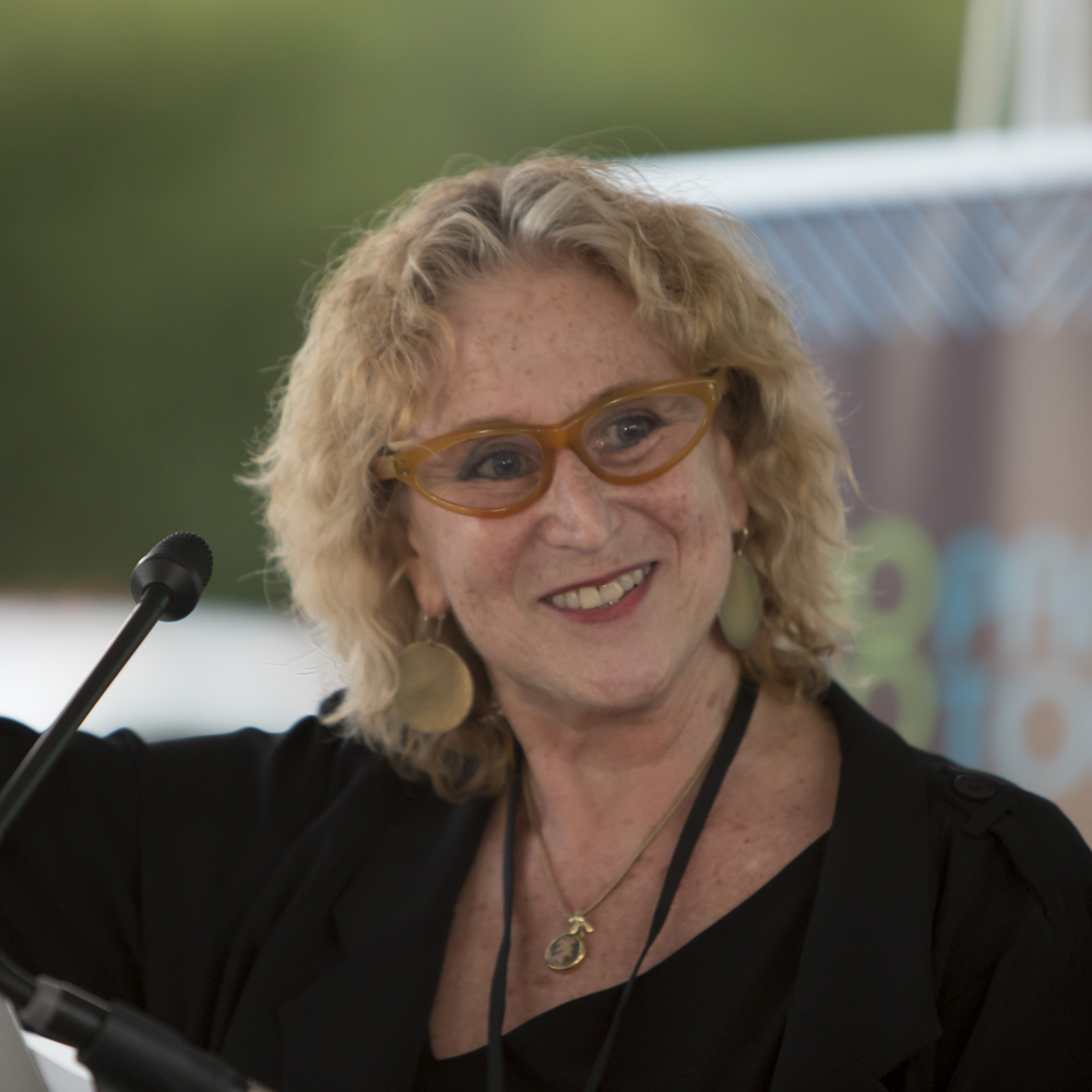 Photo of Executive Director Penny Balkin Bach speaking at OPEN AIR celebration