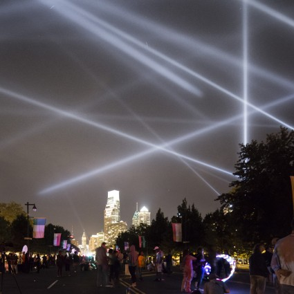 "Participants along the Benjamin Franklin Parkway look out on ""OPEN AIR"" by Rafael Lozano-Hemmer from Eakins Oval"