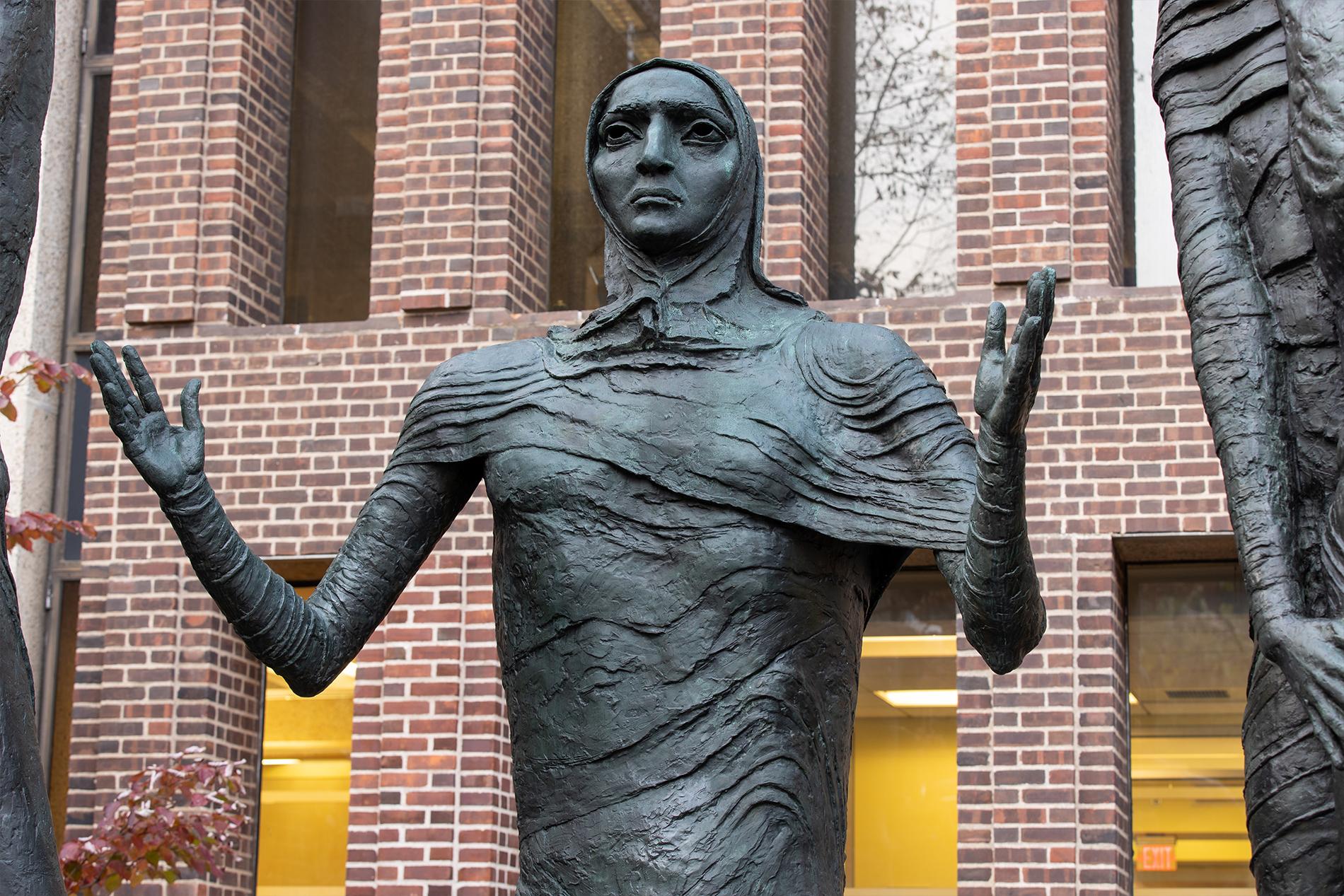 Detail of outdoor sculpture on University of Pennsylvania's campus – bronze figure