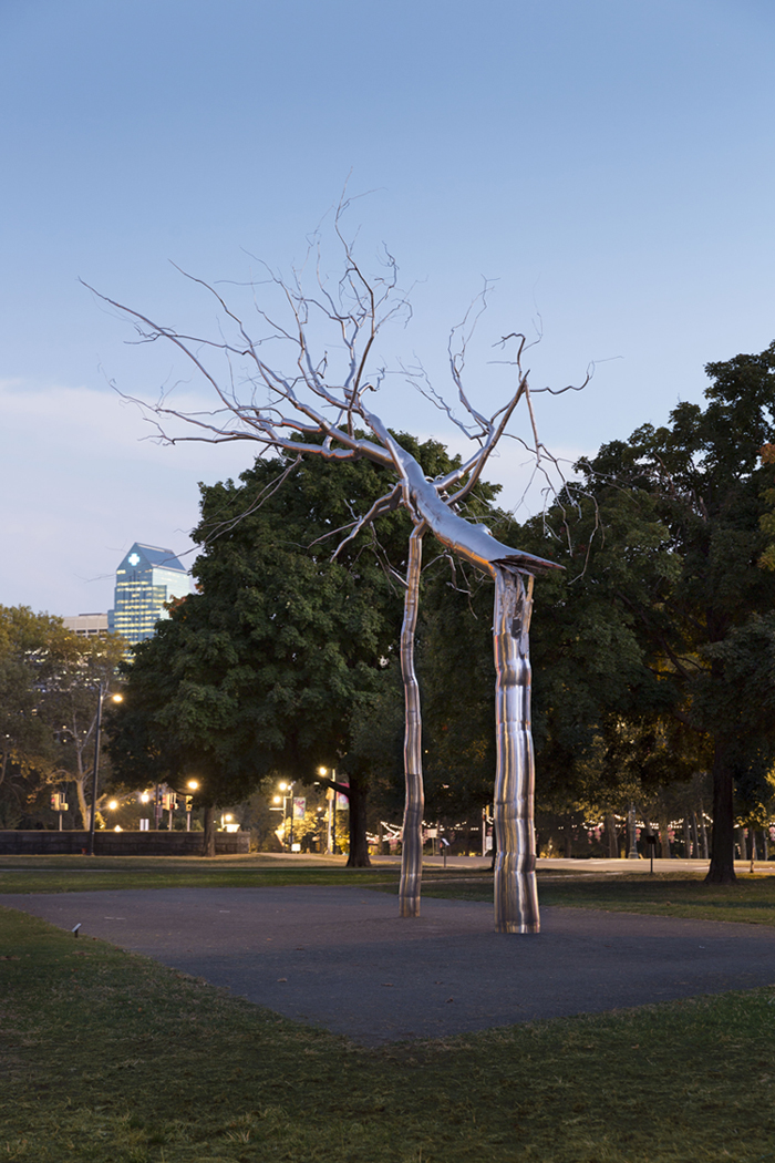 Roxy Paine's Symbiosis sculpture at twilight