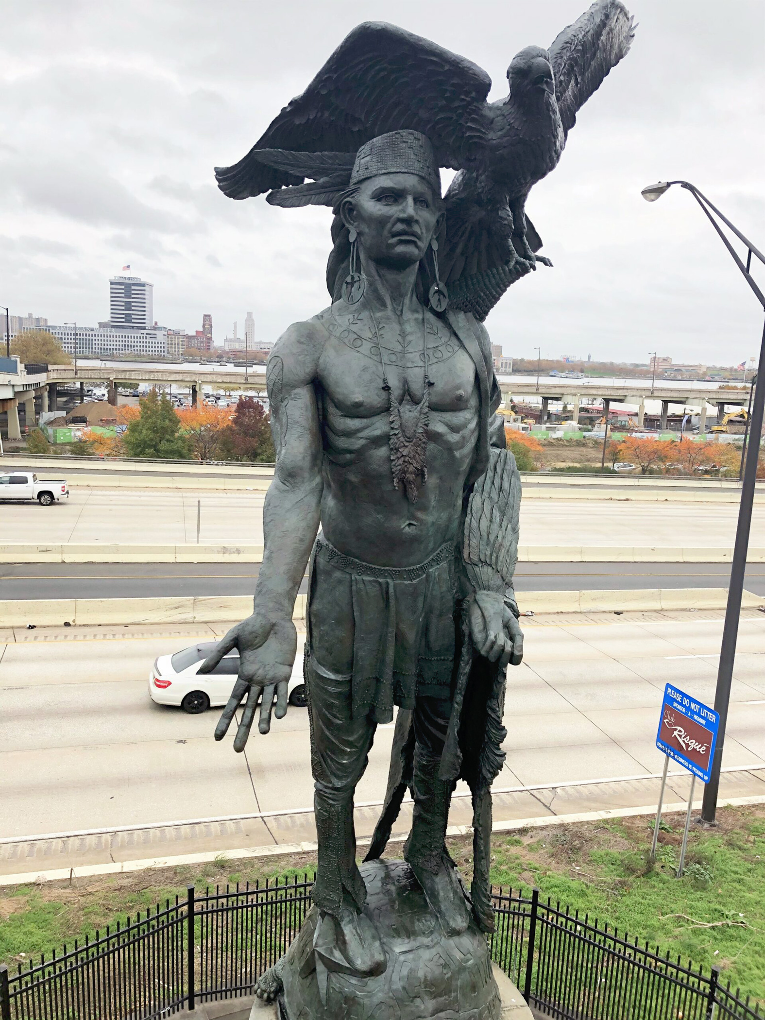 """""""Tamanend"""" Native American bronze sculpture in the city of Philadelphia after a recent conservation treatment. Figure has one arm outstretched with a bird on his shoulder and he stands on a turtle."""