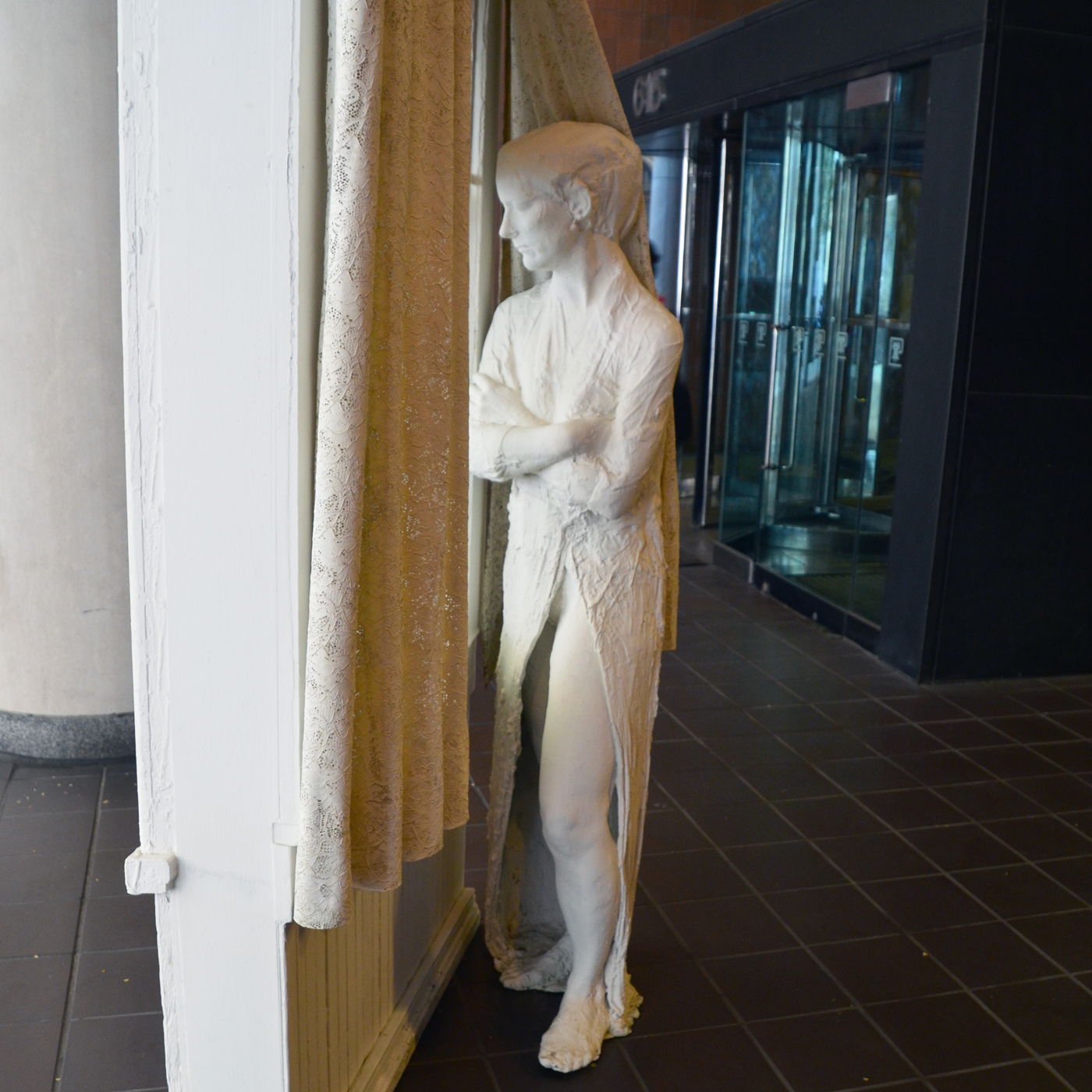 Woman Looking Through a Window - Association for Public Art