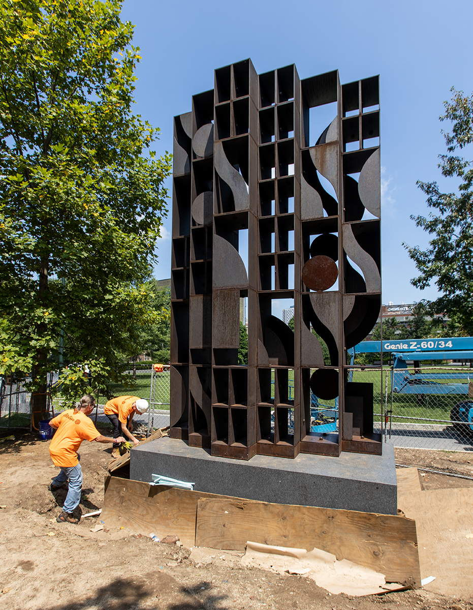 Installing Louise Nevelson bronze geometric sculpture, Atmosphere and Environment