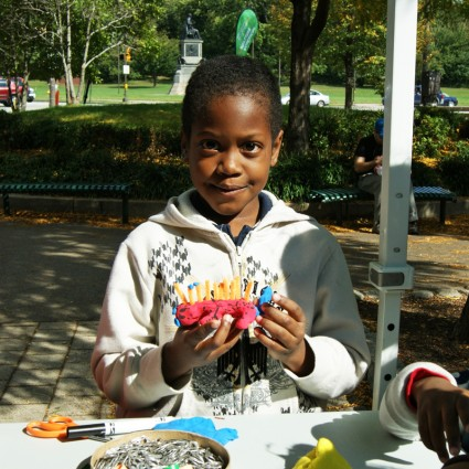 Young boy shows off his sculpture creation at Sculpture Saturdays on Kelly Drive