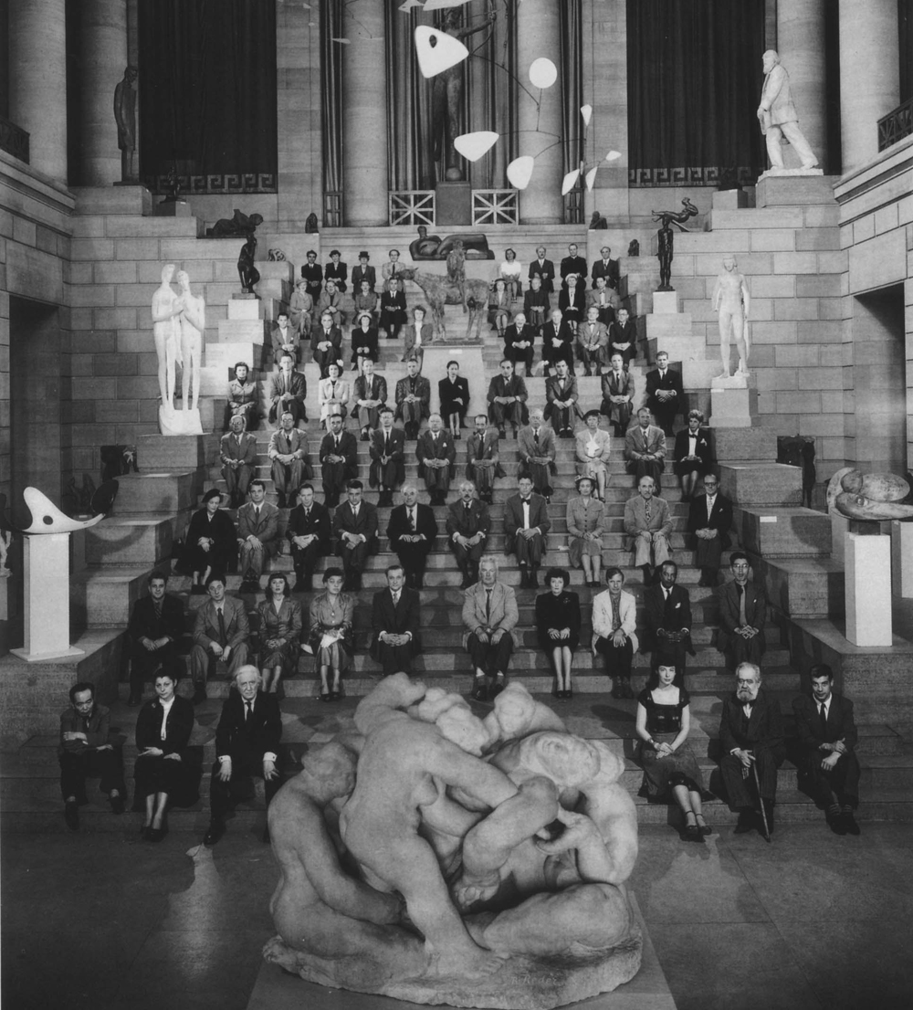Artists of the third Sculpture International seated on the steps of the Philadelphia Museum of Art