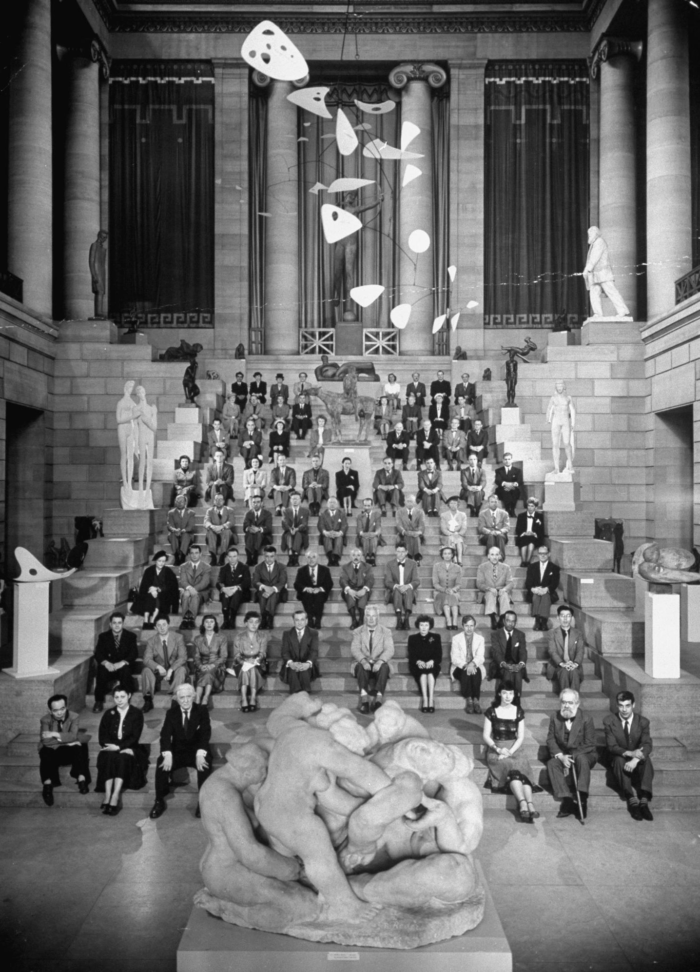 Sculptors posing for a group picture at the Philadelphia Museum of Art during the 1949 Sculpture International.