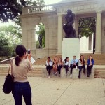 """Group taking a photo with """"The Thinker"""" sculpture while posing as """"The Thinker"""""""