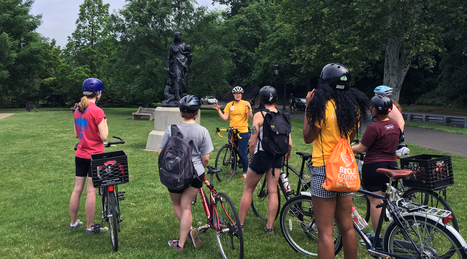 A public art Bike Tour led by the Association for Public Art stops at John J. Boyle's Stone Age in America