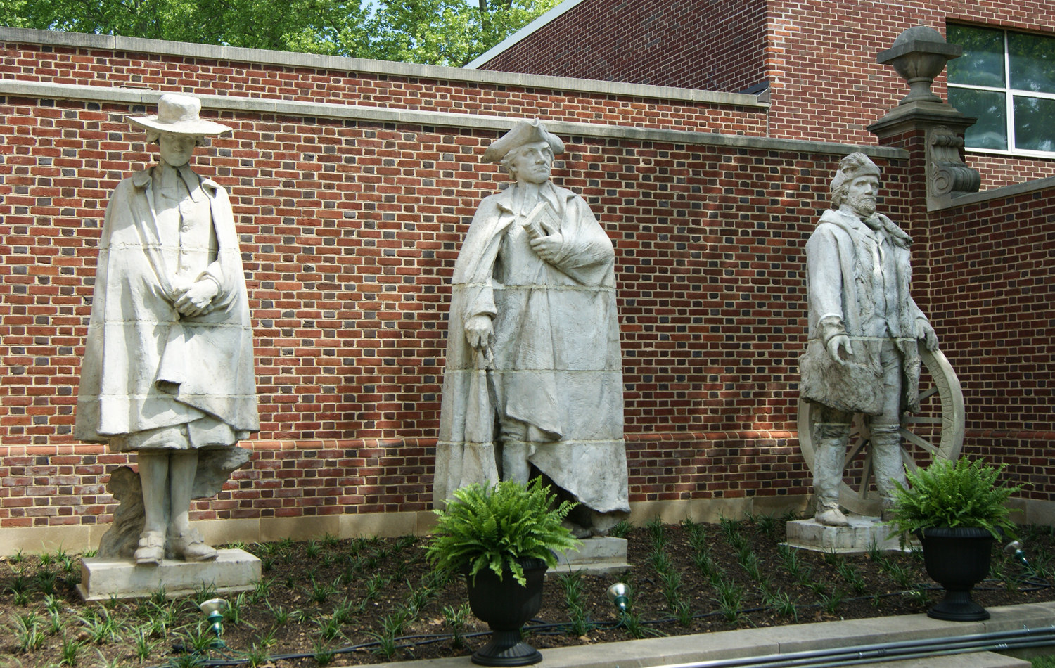 Statues of Davie, Caldwell, and Whitman standing to the right of the Historical Society building