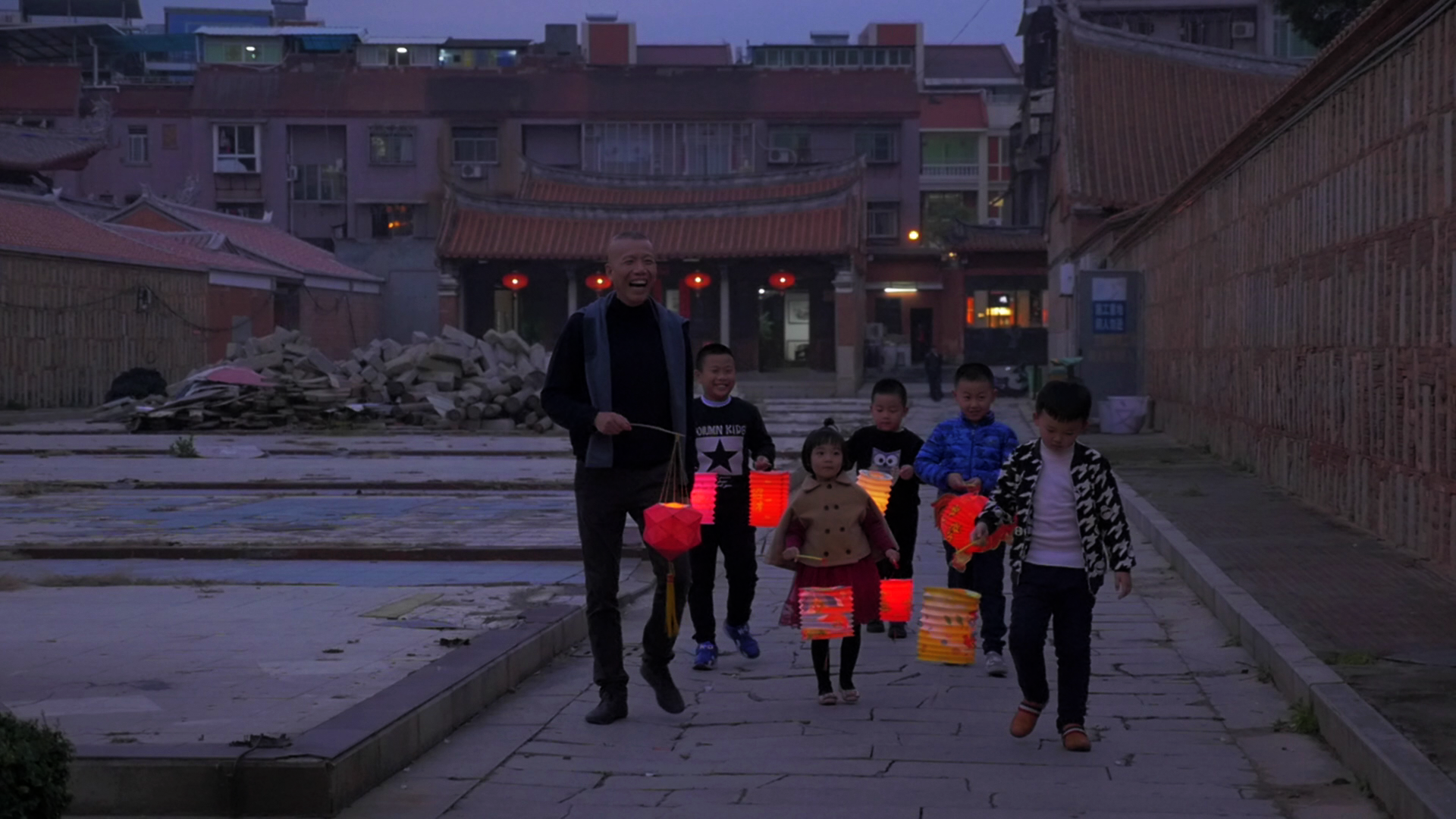 Cai Guo-Qiang with children and lanterns in Quanzhou, China
