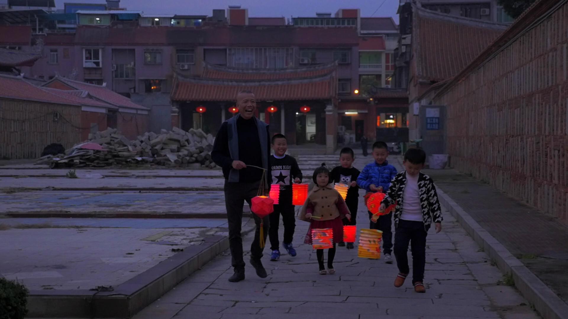 Cai Guo-Qiang with children and lanterns in Quanzhou, China