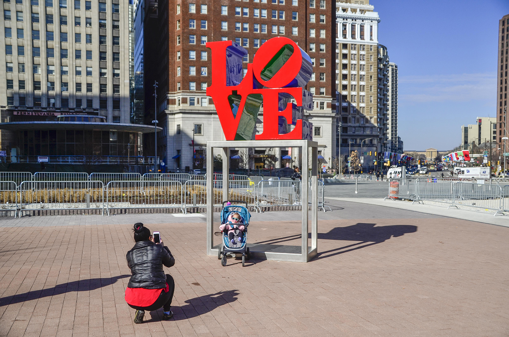 Photo being taken at the LOVE sculpture in LOVE Park, Philadelphia