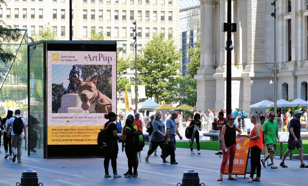 #ArtPup social media campaign on screen in Dilworth Park.