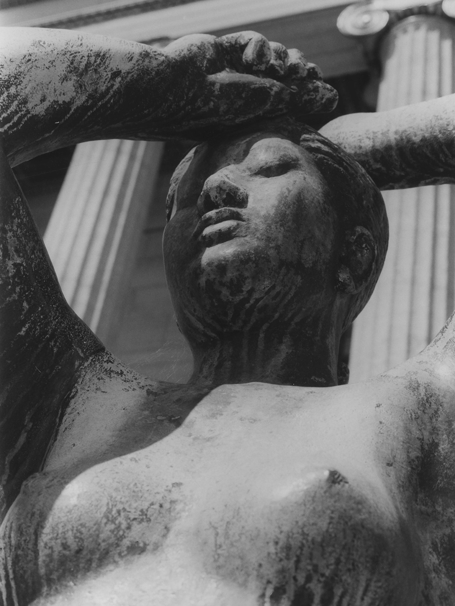 A detail of Maja sculpture, a nude figure with arms overhead