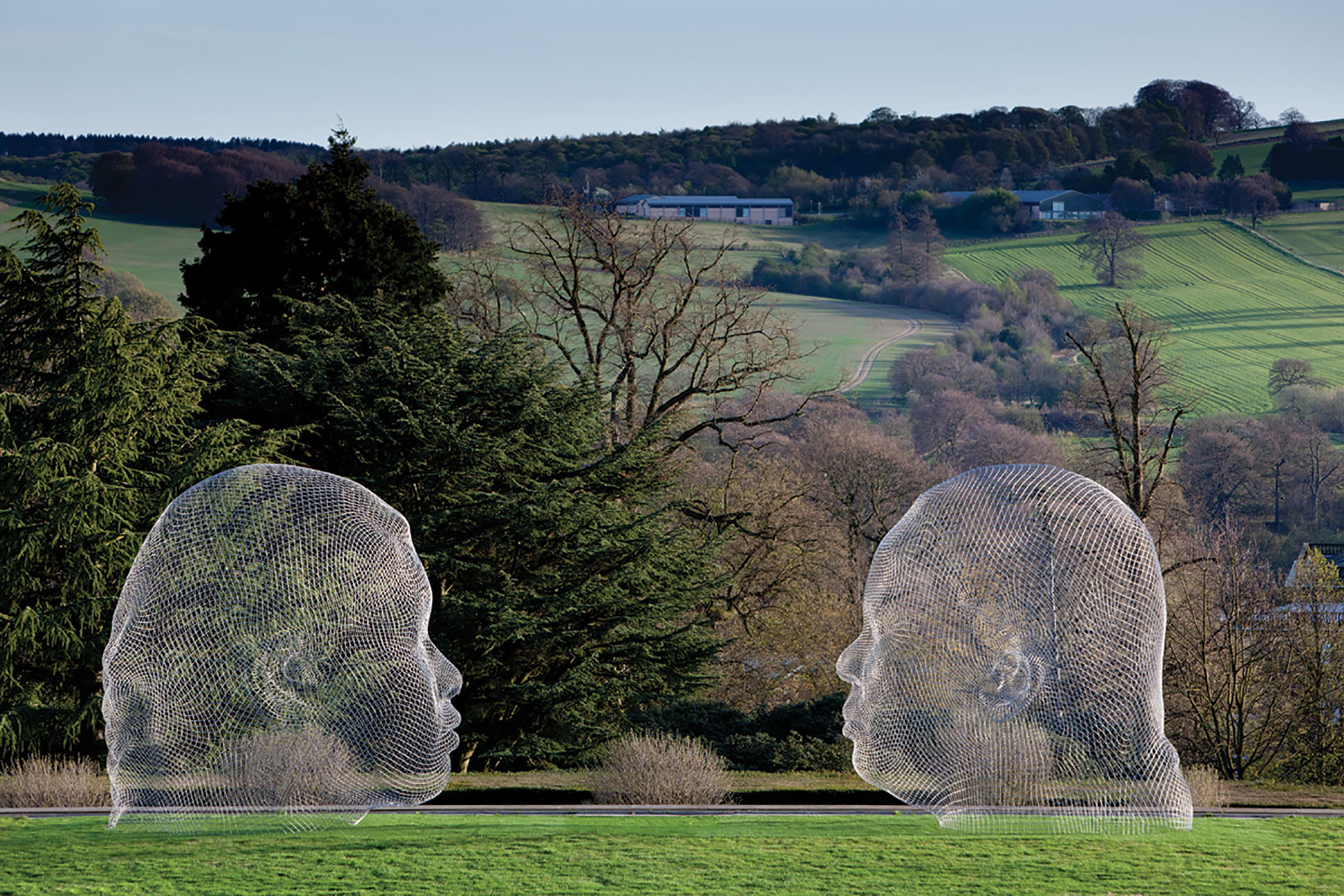 Jaume Plensa sculpture at Yorkshire Sculpture Park - two large heads facing each other