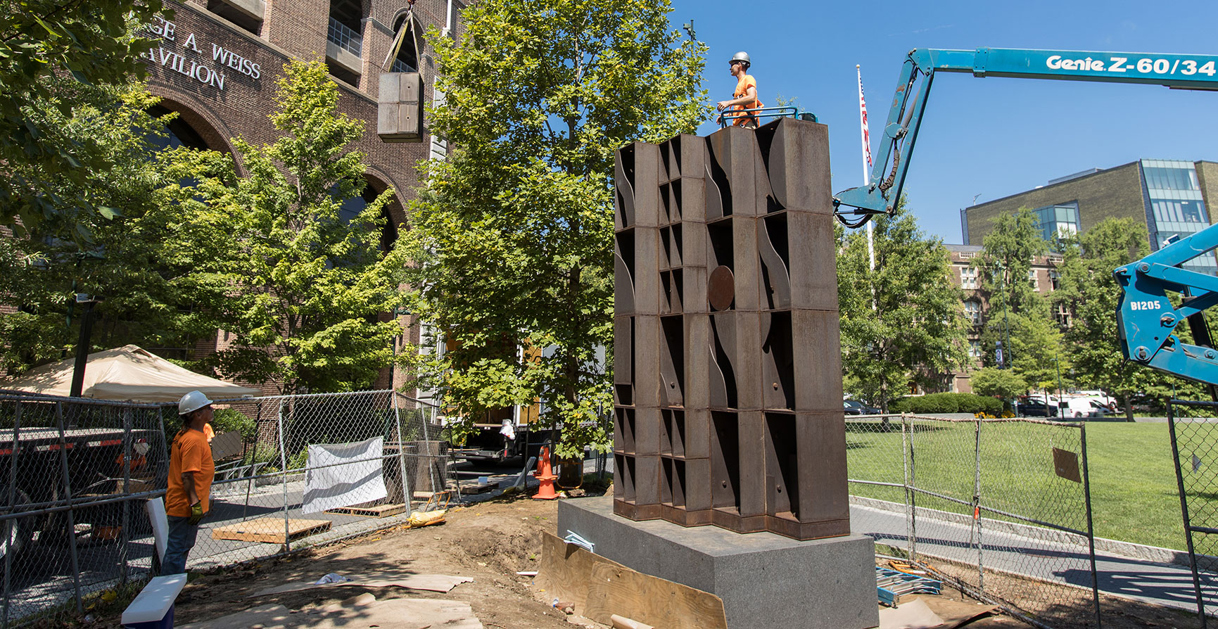"Installation of Louise Nevelson's bronze, geometric ""Atmosphere and Environment"" sculpture on Penn's campus"