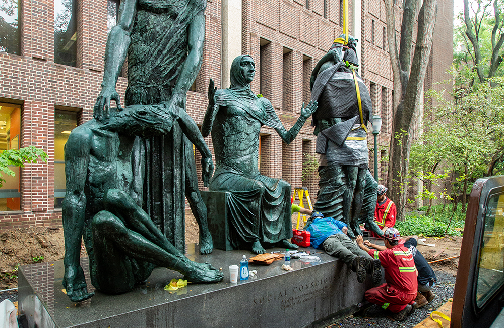 Installing four bronze figured sculptures on Penn's campus
