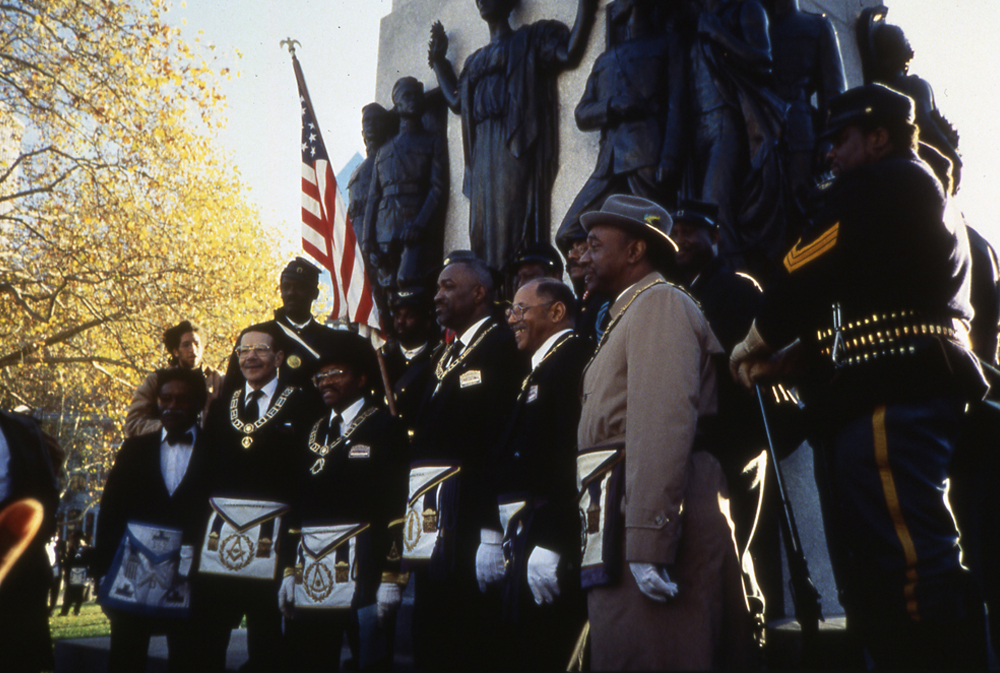 Men in front of the memorial at the rededication in 1994 on the Parkway