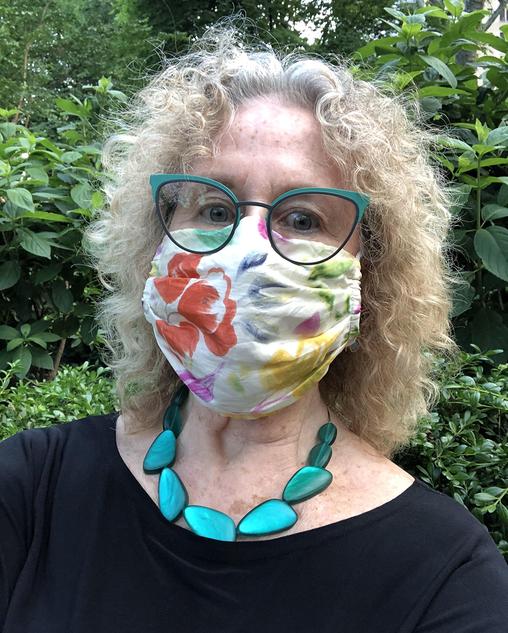 Executive Director of the Association for Public Art, outside with a floral mask on