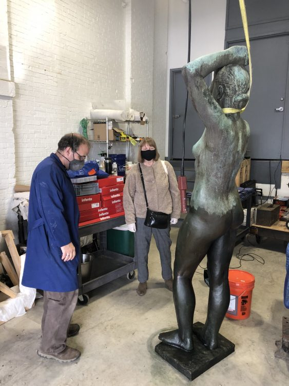 A protective wax coating applied to the lower half of the sculpture. This wax also saturates and darkens the bronze to provide a more unified surface appearance. Photo © Caitlin Matin for the Association for Public Art.