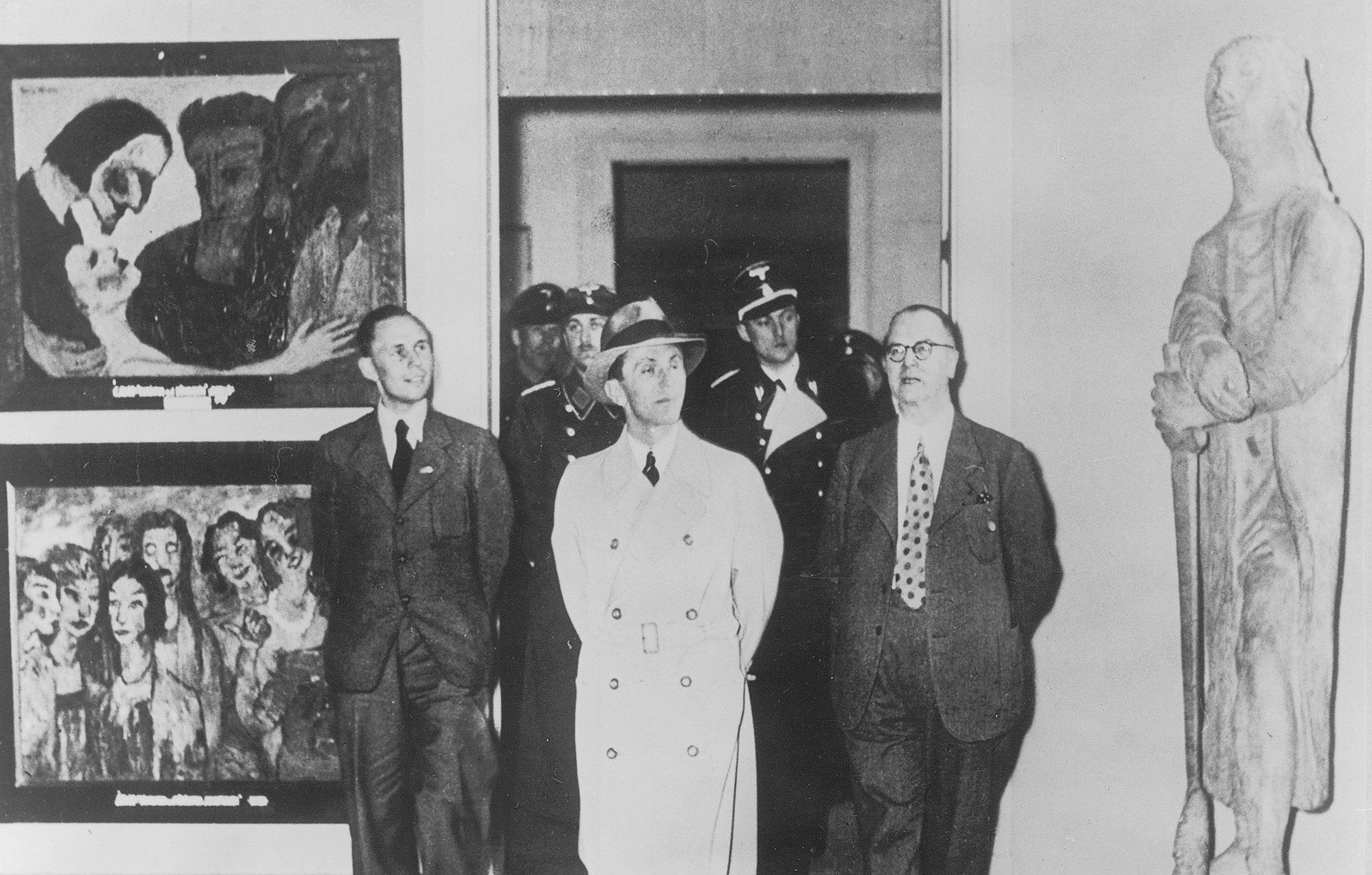Joseph Goebbels, the German Nazi politician, views the Degenerate Art Exhibition, which included Gerhard Marcks' work.