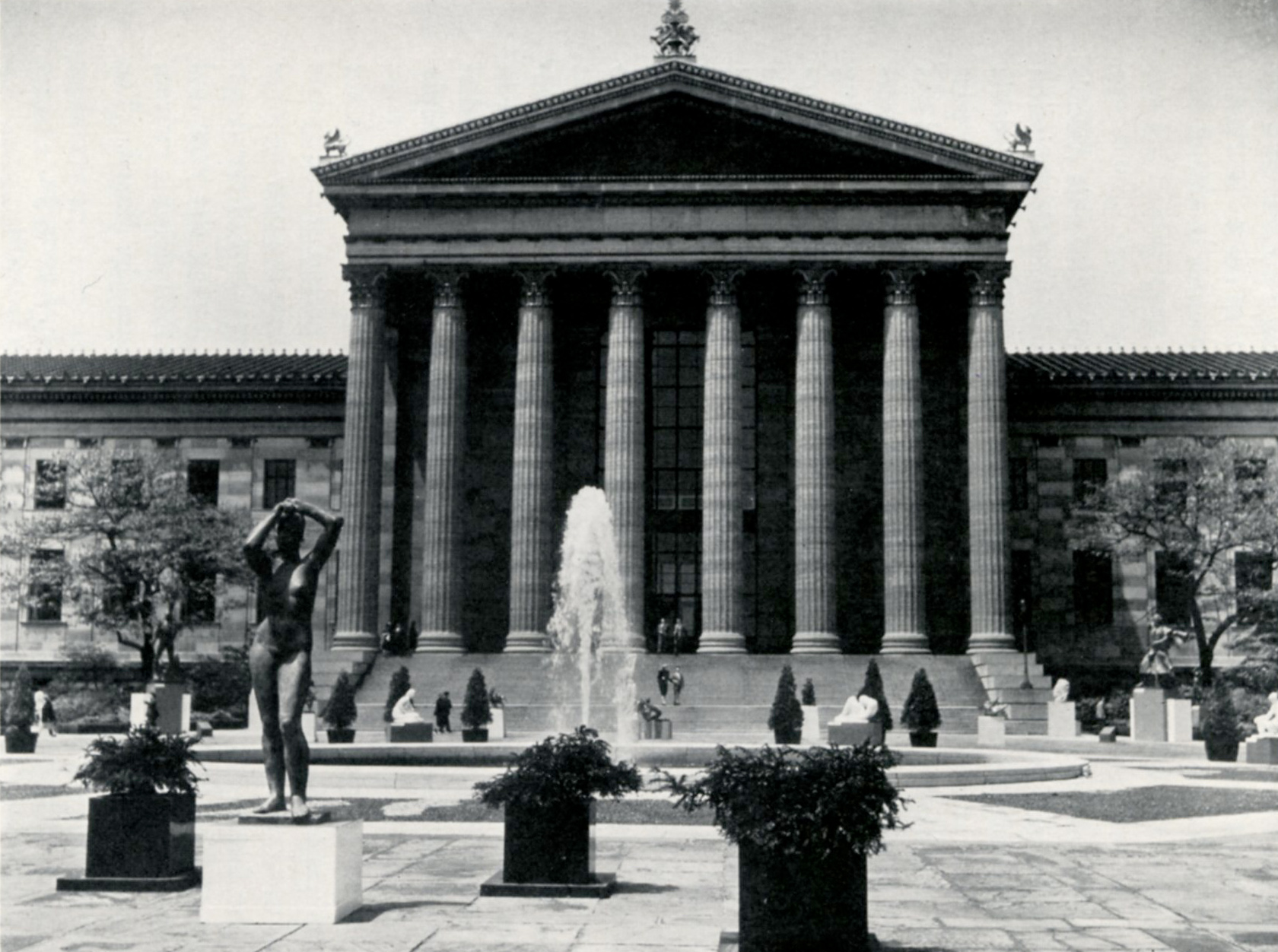 Black and white photo of the bronze nude Maja at the Association for Public Art's Third Sculpture International Exhibition in 1949, seen here in front fo the Philadelphia Museum of Art on the East Terrace