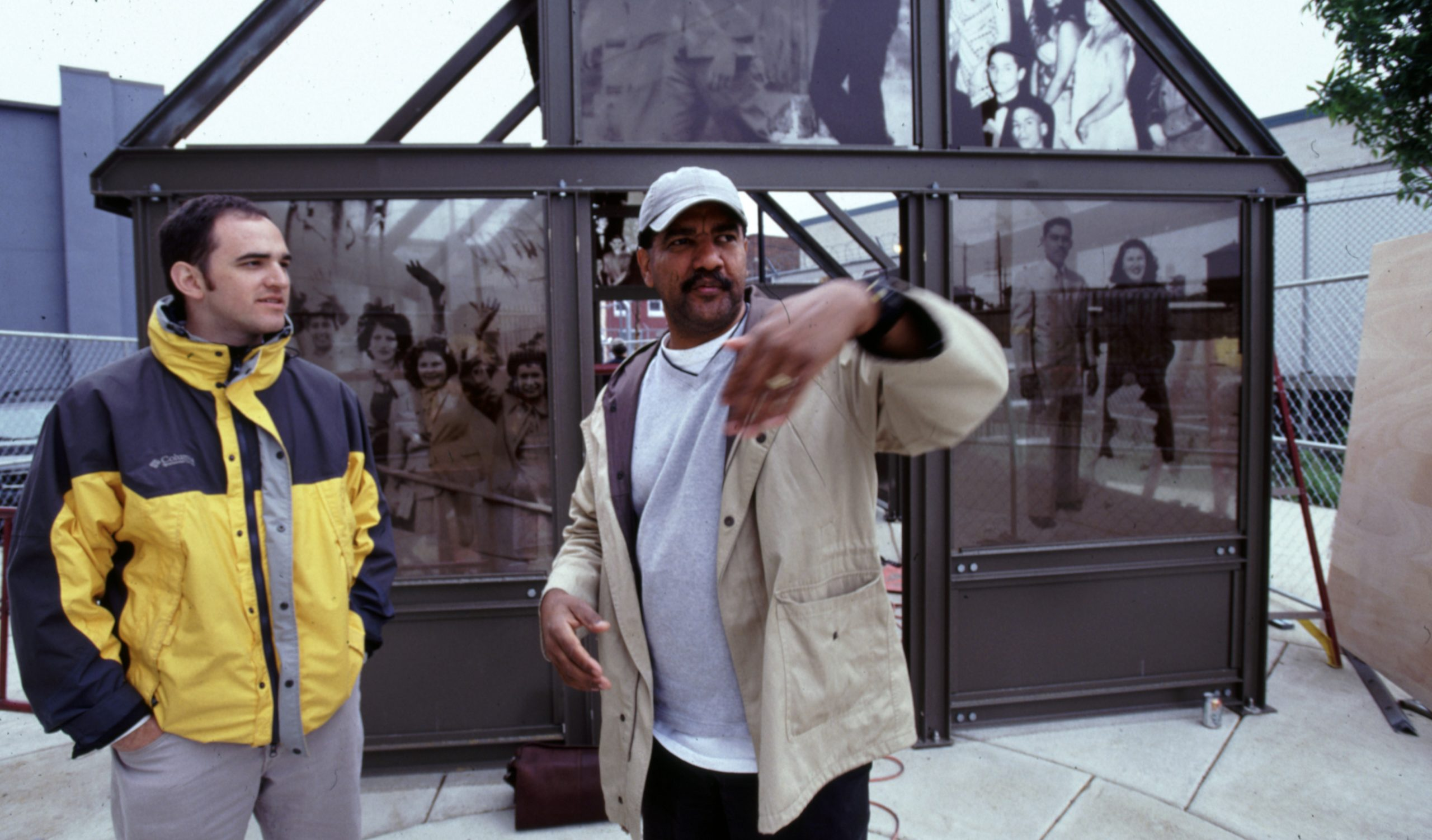Artist Pepón Osorio in front of his public art installation in North Philadelphia in 2003